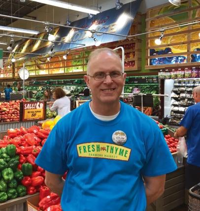 Store Manager Chris Gilbert inside the new Fresh Thyme Farmers Market in Ashwaubenon.
