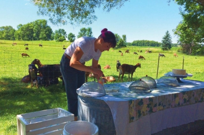 Apprentice cheesemaker Natalie Ihde preparing a cheese-tasting at The Door County Creamery's farm. Contributed photo