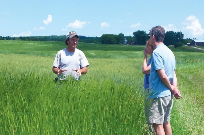 David Meuer out in his field with visitors. Contributed photo
