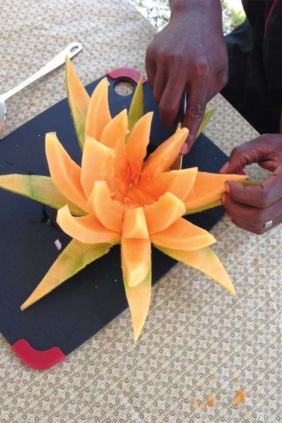 carving a cantaloupe