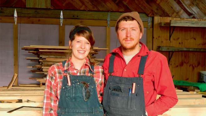 Sarah McCarty and Ben Blohoweak in their barn at Cold Climate Farms