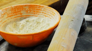 Bowl of flour and rolling pin